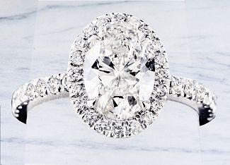 1.57 Carat GIA OVAL Diamond Engagement Ring - Platinum and Diamond Halo Setting